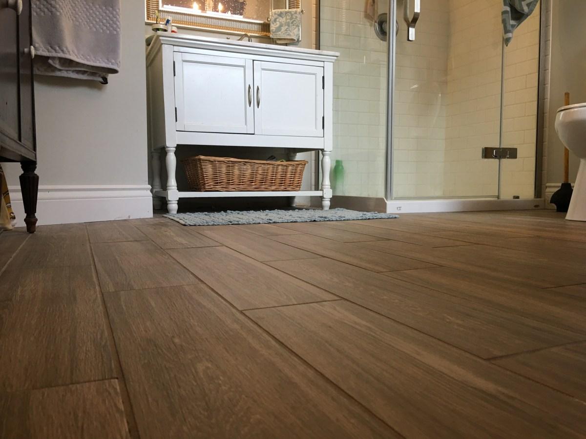 Beautiful bathroom with wood-look floor