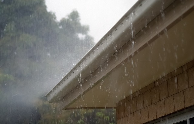 Rainwater spilling over gutters in a rainstorm