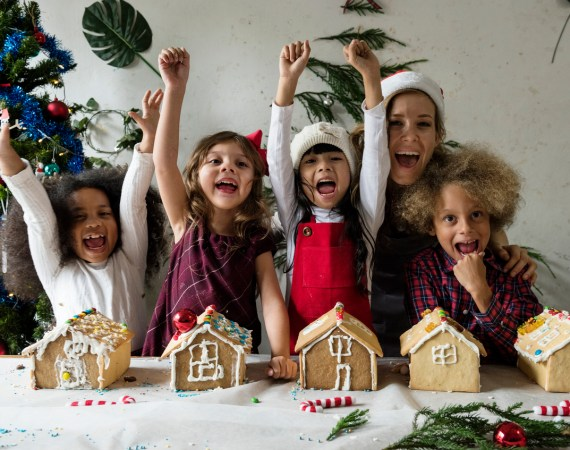 Happy kids with their gingerbread houses