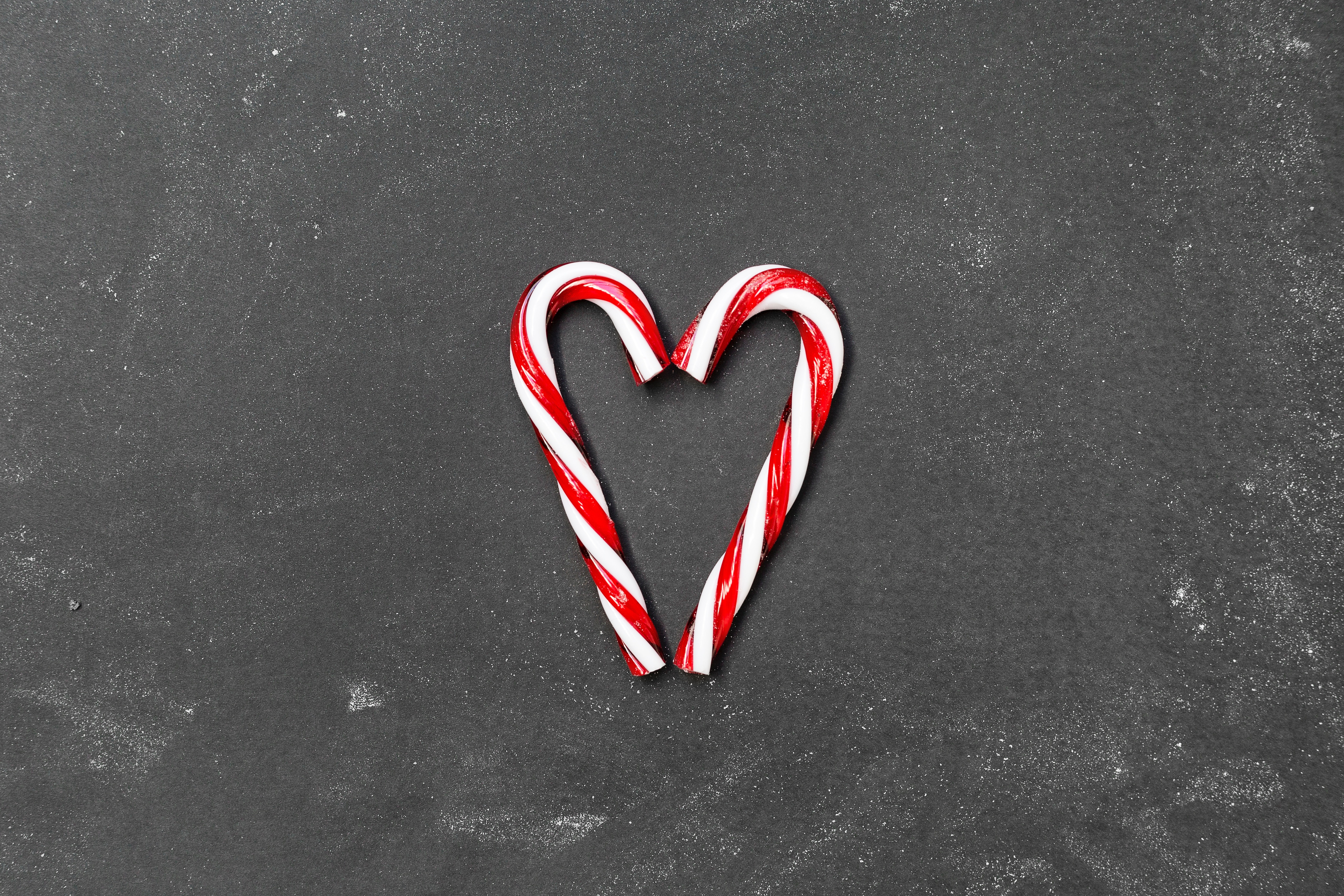 Two candy canes in the shape of a heart