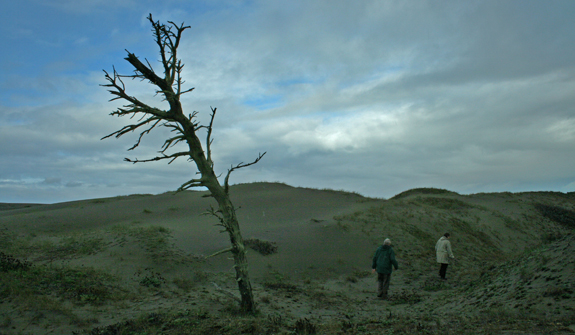 Walking through the encroaching dunes.