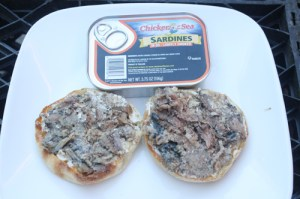 The sardines' supple flesh has been spread over the muffins.