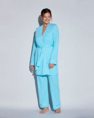 Woman wearing blue pajamas for breastfeeding.