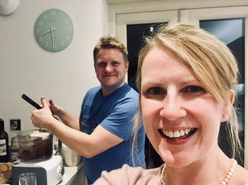 picture of Mum and Dad baking a first birthday cake  - Cotswold Baby Co