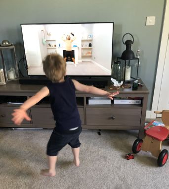 Henry doing Joe wicks workout - cotswold baby co