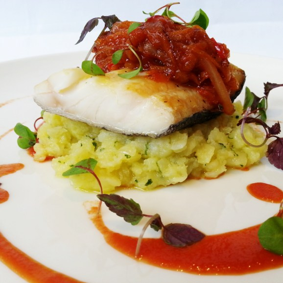 Whitby Smoked Haddock, Crushed New Potatoes, Confit Peppers and Tomato Sauce from The Black Swan in Helmsley
