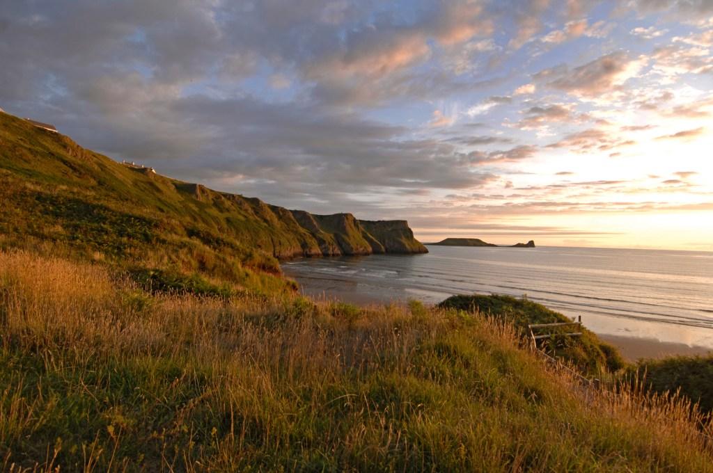 Sunset over Rhossili Beach, Gower Penninsula, South Wales