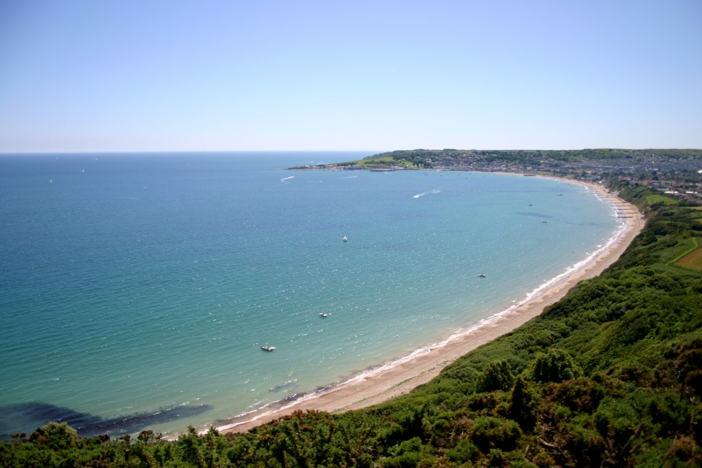 Swanage bay, in Dorset, England, on sunny summer's day. Aerial view.