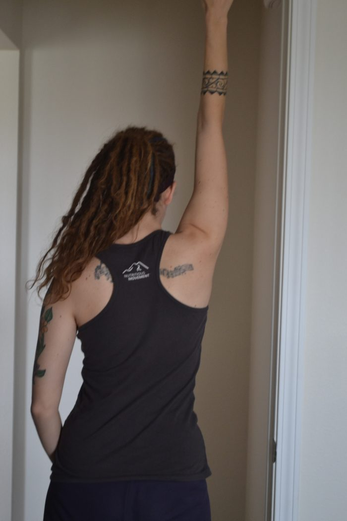 A variation of a shoulder stretch for postpartum tension.