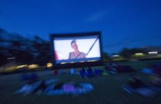 an outdoor movie screen showing the star wars movie