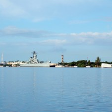 Arizona and Missouri Memorials scene across Pearl Harbor on the island of Oahu in Hawaii.