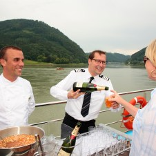 Champagne served on the top deck beside gorgeous scenery in Europe