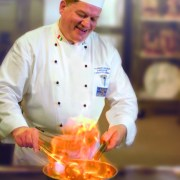 Chef flambes a dish