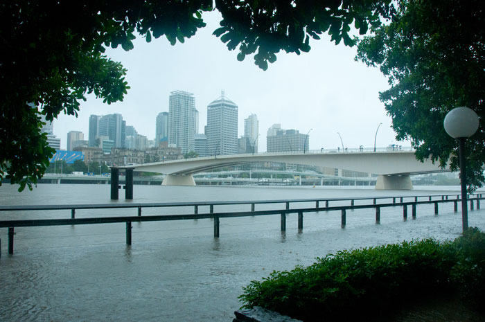 An Australian city in flood (view of a city and bridge in the foreground)