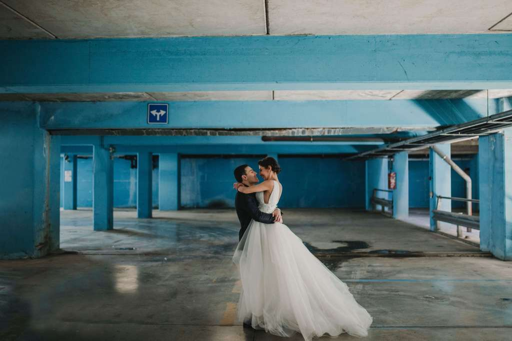 married couple in a garage