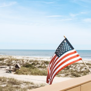 Flag waving of desk on beach