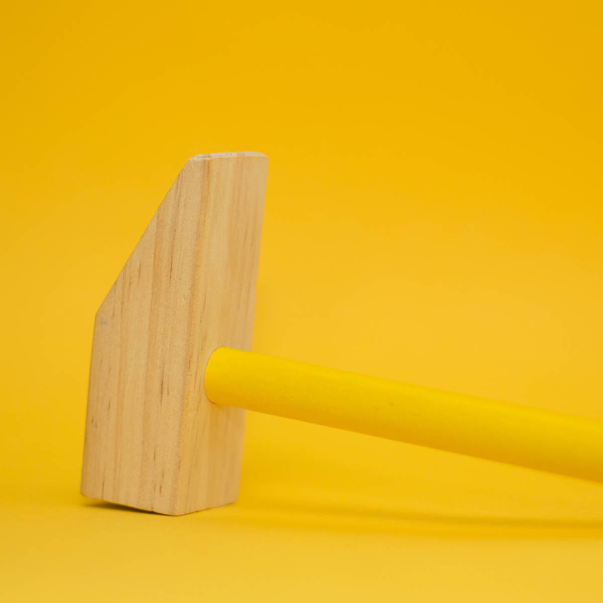 yellow hammer with yellow background