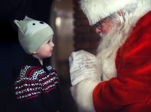 toddler talking to a Santa Claus