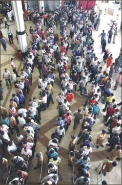 People are in a long queue to 'win' bus tickets for leaving Dhaka before Eid