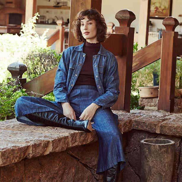 Look calça jeans com bota cano longo