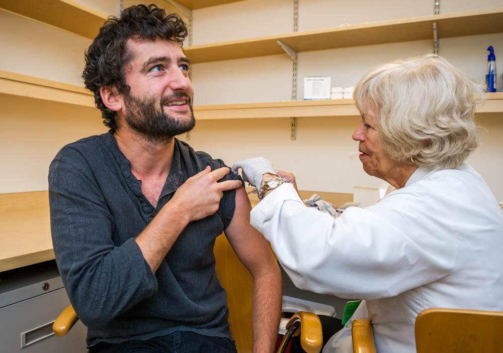 Flu shot clinic 2014. Raphael Ceccaldi, Ph.D. getting his flu shot.