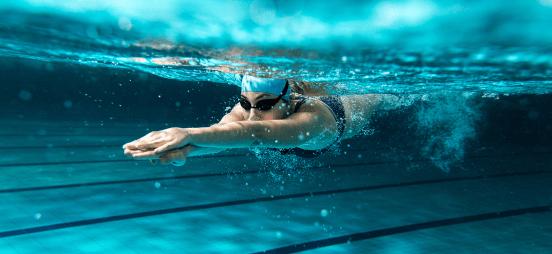 women-swimming-under-water