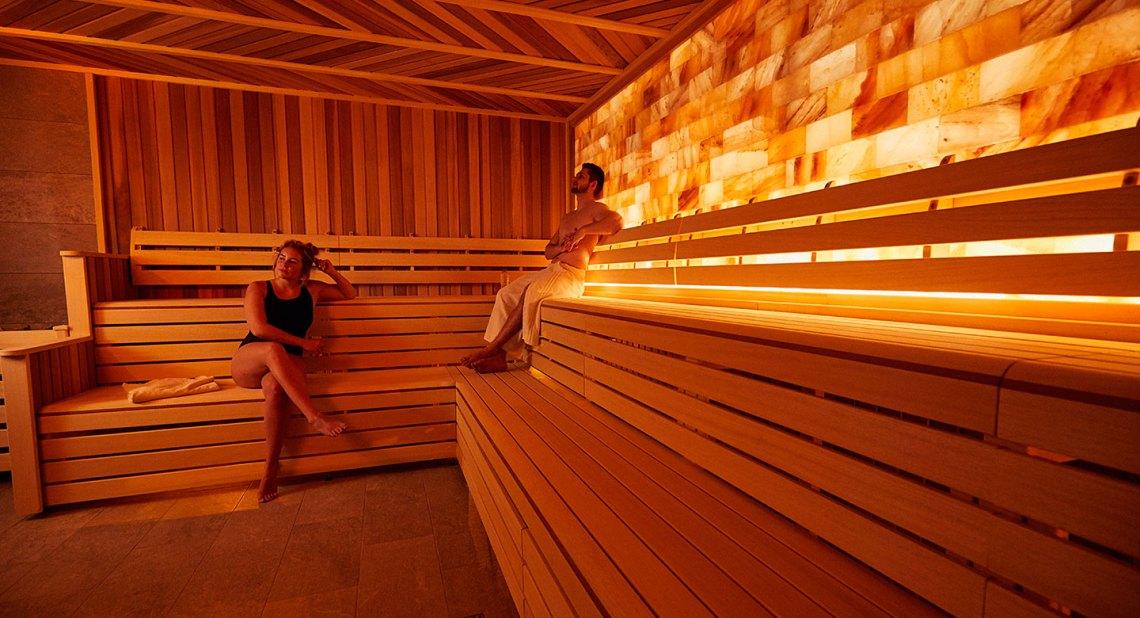 Image of a woman and a man sat in the salt spa at David Lloyd Royal Berkshire