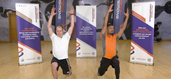 Olympian Dave Ryding and Davd Lloyd Trainer performing lunges