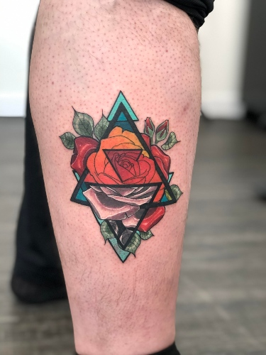 a geometric triangle and rose tattoo by Birdie