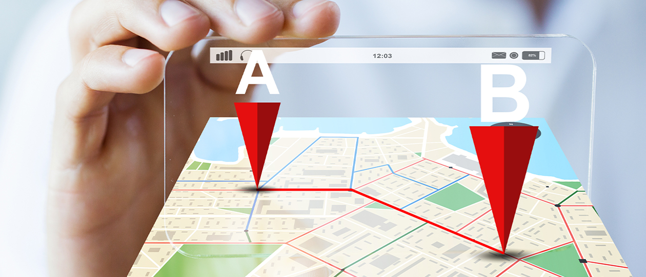 A hand holding a 4D illustrated map. There are two points on the map. Location A uses geotargeting to effectively find their ideal consumer, which is at the second point, Location B.