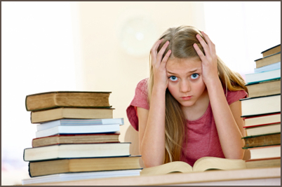 Stressed little girl with pile of books around