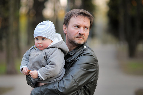 40486657 - middle age father with his toddler son walking outdoors / kidnapping concept