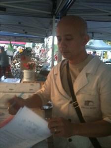 Bien Peralta signing the Dello Mano 29 Doggett St. Teneriffe lease