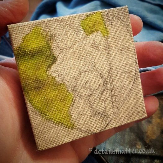 Canvas work in progress of teddy bear peaking out from a tree in a heart on toned miniature box canvas
