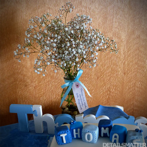 christening tag on vase table decoration kraft card with calligraphy name and dates