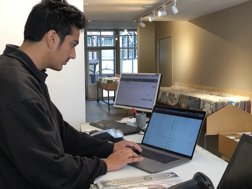 Sameer from 3345 Records using NearMint to manage his record and CD inventory