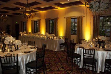 Yellow uplighting for wedding