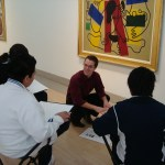 Justin Greenlee in the galleries with students from W. E. Greiner Exploratory Arts Academy