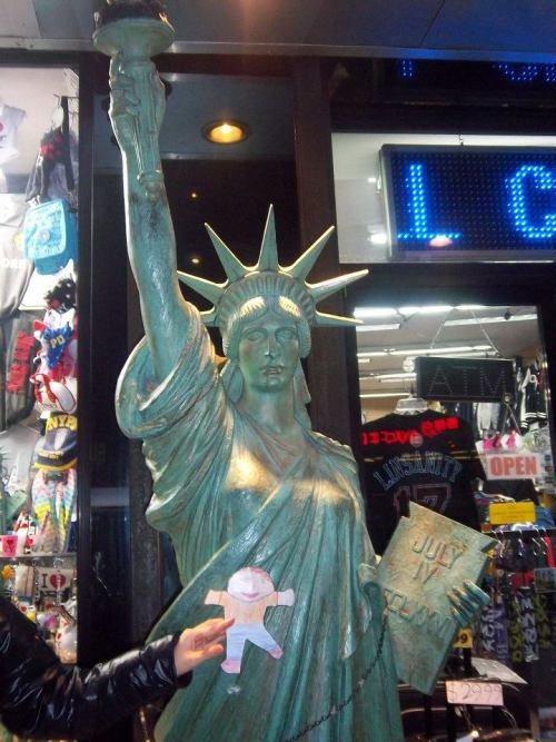 With a replica of the Statue of Liberty in New York