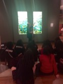 Docent Susan B. teaches the students about marine biology and our Tiffany Glass Windows.
