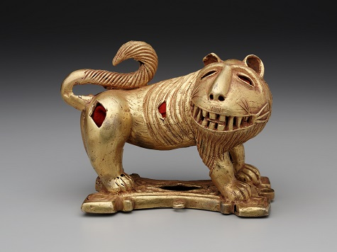 Sword ornament in the form of a lion, Asante peoples, Ghana, Africa, c. mid-20th century, cast gold and felt, Dallas Museum of Art, The Eugene and Margaret McDermott Art Fund, Inc. 2010.2.McD