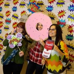 Educators enjoying the Pop-themed photo booth