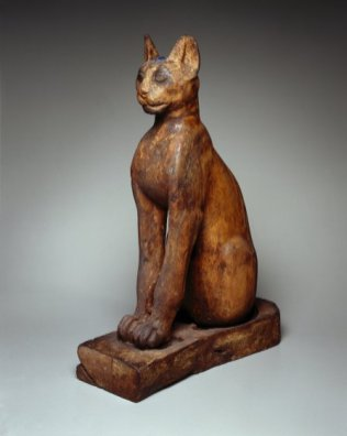 Figure of a Cat. From Egypt. Ptolemaic Period–Roman Period, 305 B.C.E.–first century C.E. Wood, gilded gesso, bronze, rock crystal, glass, Brooklyn Museum, Charles Edwin Wilbour Fund, 37.1945E, Divine Felines: Cats of Ancient Egypt is organized by the Brooklyn Museum