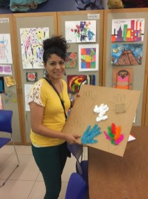 A workshop participant shows off her sensory board.