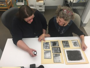 Archivist Hillary Bober and Associate Conservator Fran Baas look through Museum scrapbooks from the 1950s.