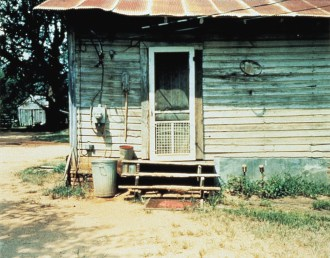 "William Christenberry, ""White Door, Near Stewart, Alabama,"" 1980, EverColor photograph, Dallas Museum of Art, gift of DMA Friends of Photography, courtesy Pace/MacGill Gallery, New York, 1998.82, © William Christenberry"