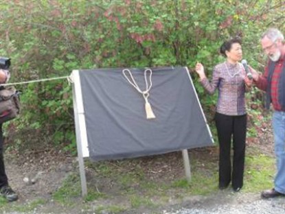 Madam Tan of the Chinese Consulate ready to unveil the new interpretation at Arrowtown Chinese Settlement.