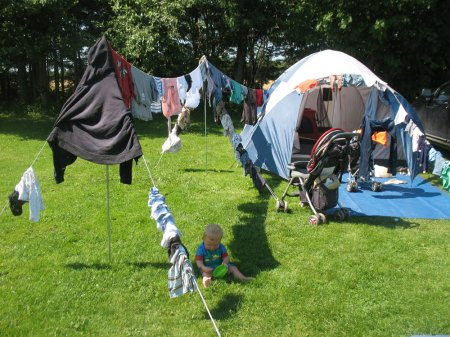 Camping, tent and lots of laundry.