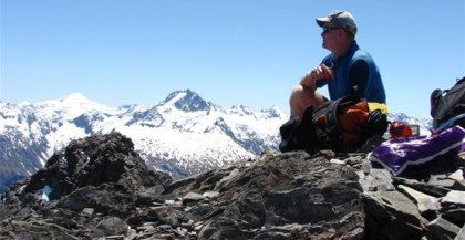 Dean Nelson sitting on top of the Dalser Pinnacles.