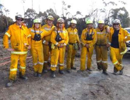 The DOC firefighting crew with a couple of Tasmanian mates that have been working with them.